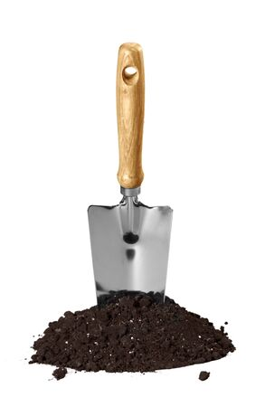 Dirt and a Shovel on white Stockfoto
