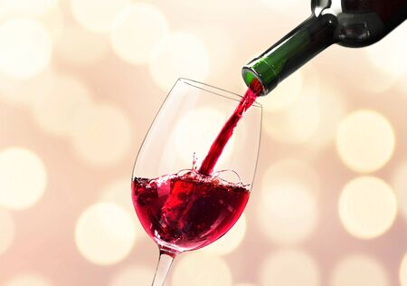Red wine and glass on bokeh