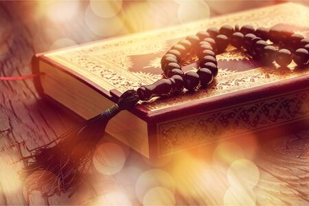 Islamic Holy Quran and Subha on Soft Light