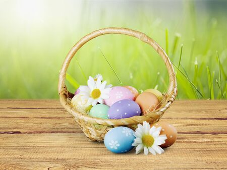 Easter Basket on wooden table Фото со стока