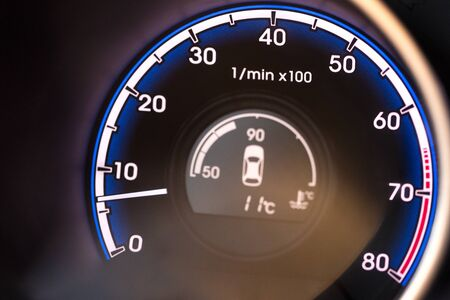 Close up of a Tachometer in a Car