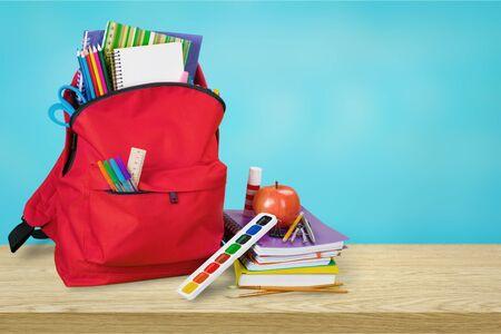 Blue School Backpack on wooden table Stok Fotoğraf