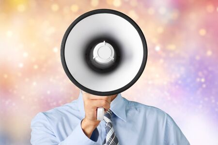 Young businessman talking on the megaphone