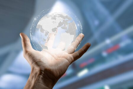 Businessman holding in hand with global connection concept. Stock fotó