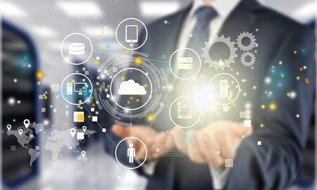 Businessman and analytics symbols on blurred