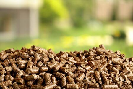 Pellets Biomass with green bokeh