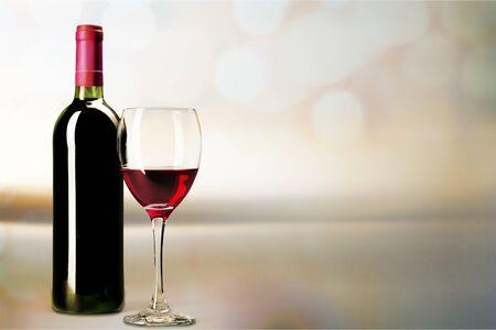 Red wine glass  on light bokeh 写真素材