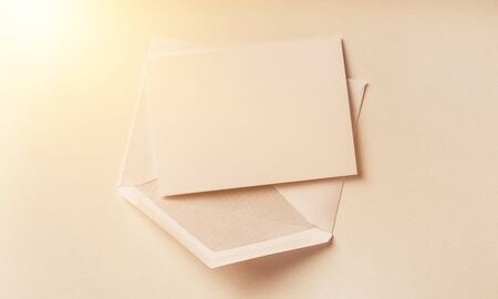 Blank card and envelope over white Foto de archivo - 130154609