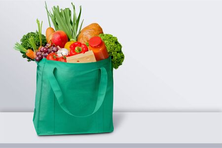 Full shopping  bag on table  on wooden table 版權商用圖片