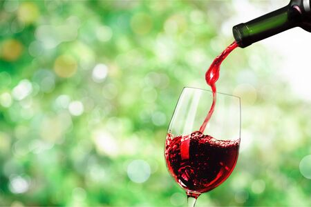 Red wine and glass on green 写真素材