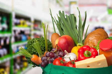 Full shopping  bag on hypermarket Foto de archivo - 130154375