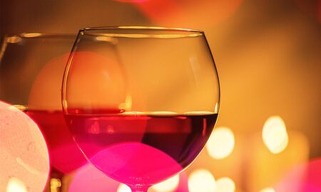 Wine glasses in a restaurant setting close up