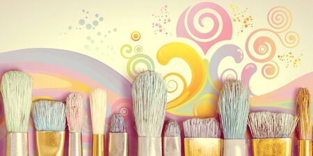 Row of artist paint brushes