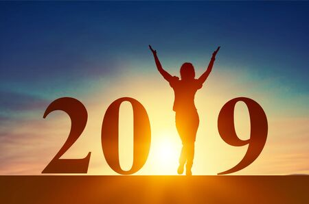 Silhouette of business woman feel excited with 2019 year