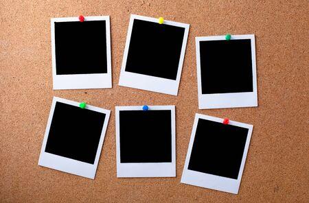 Blank photographs on a bulletin board