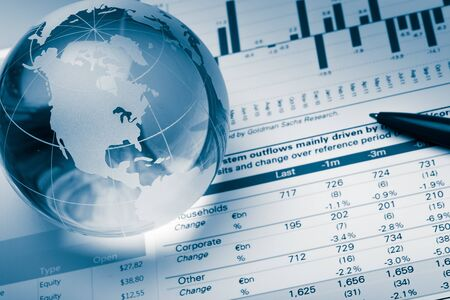 Business Graphs and Charts with Glass Globe Stockfoto