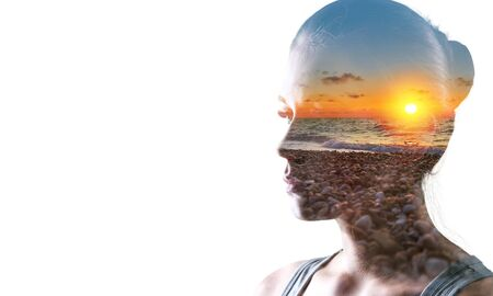 Psychoanalysis and meditation, concept. Profile of a young woman and sunset over the ocean, calm and mental health. Image with double exposure effect. The subconscious and how the brain works.          - Image Archivio Fotografico