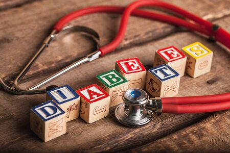 Diabetes and stethoscope. Medecine concept. Cubes with word diabetes and stethoscope
