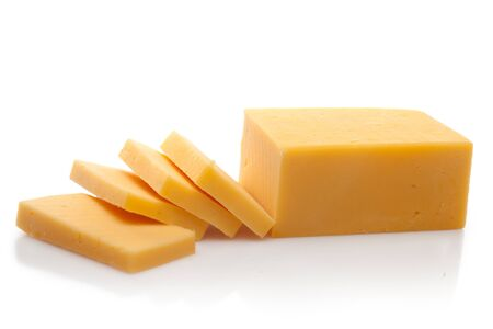 Piece and Sliced of Cheddar Cheese Imagens