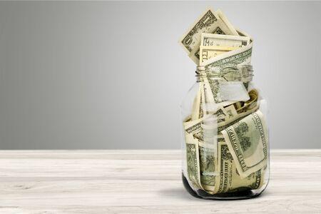 Glass jar for money on background 写真素材