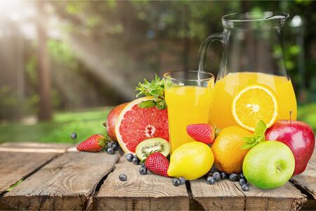 Glasses of fresh juice and fruits