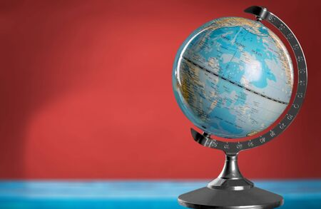 Blue globe on table