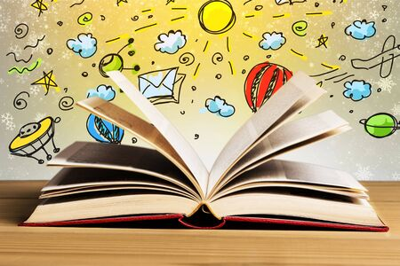 Open book on table with illustration