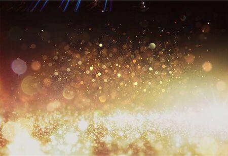 glitter vintage lights background. dark gold and