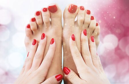 Closeup photo of a beautiful female feet with pedicure and hands with manicure Stock Photo