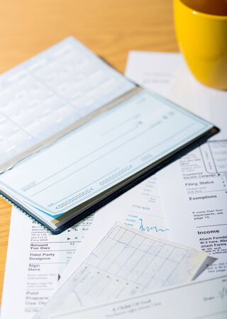 Tax Documents with Checkbook and Cup