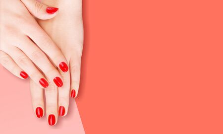 Stylish trendy female manicure. Beautiful young woman's hands on Living Coral background. Color of the year 2019 concept.          - Image 写真素材 - 133653278