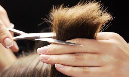 Man having a haircut with scissors
