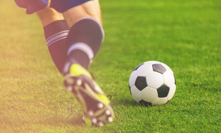 Soccer ball on the field of football Stock Photo