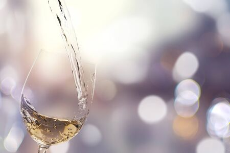 Pouring White Wine into a Glass - Isolated