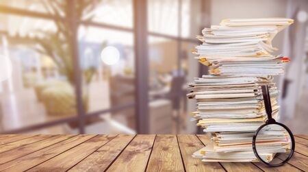 File folders with documents and magnifying glass on background