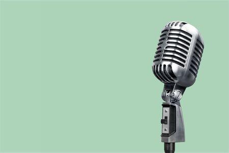 Retro style microphone on background Фото со стока
