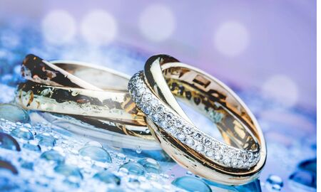 Two engagement rings from platinum and gold with diamond  on background close up
