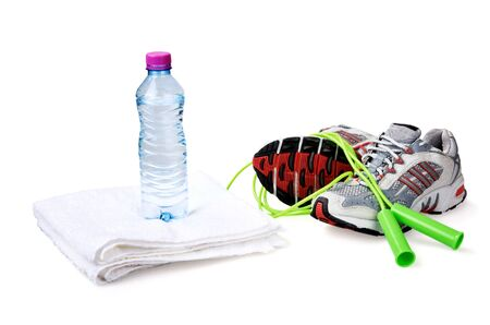 Water Bottle on Towel, Jump Rope and Sports Shoes Фото со стока - 133682624