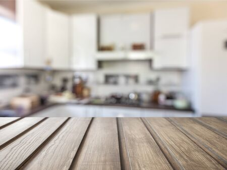 Worn table and blur with bokeh kitchen background