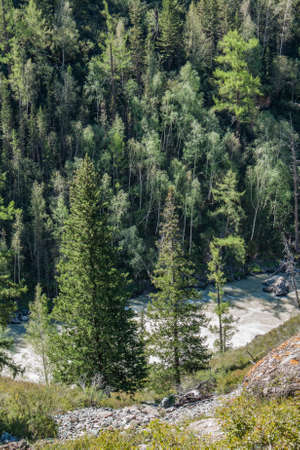 steep: Steep banks of a mountain river. Stock Photo