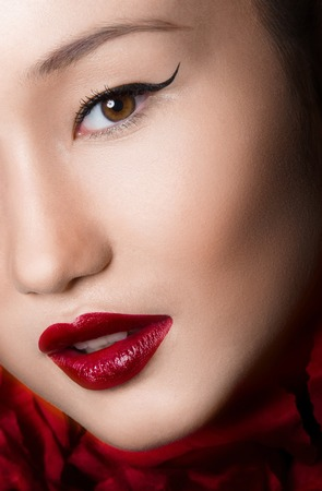 Asian Woman Close up With glamour make up and red lips. Studio fashion shot