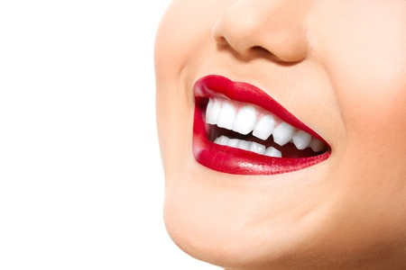red head: Perfect smile with white healthy teeth and red lips, dental care concept