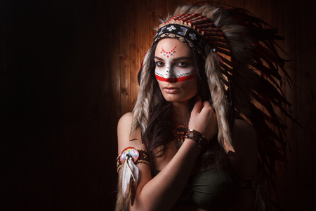 american sexy: Indian woman with traditional make up and headdress looking to the side