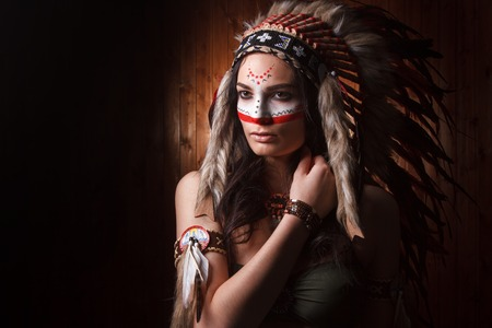 american sexy girl: Indian woman with traditional make up and headdress looking to the side