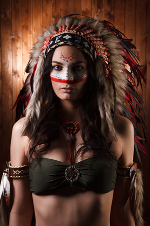 indian tribal headdress: Indian woman with traditional make up and headdress looking at camera