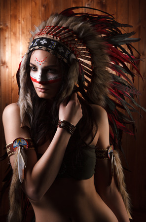 sexy woman standing: Indian woman with traditional make up and headdress looking to the side