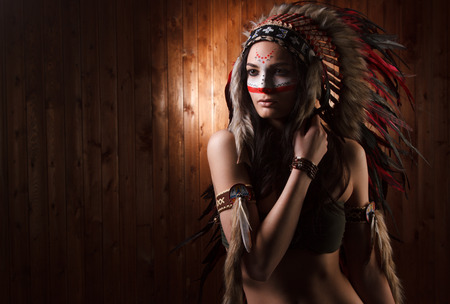 indian tribal headdress: Indian woman with traditional make up and headdress looking to the side