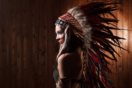 Indian woman with traditional make up and headdress looking to the side