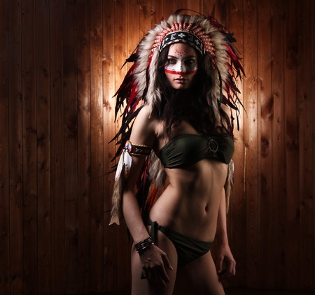 strong girl: Indian woman with traditional make up and headdress looking to the side