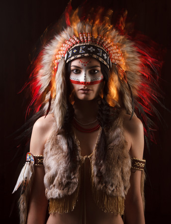 headdresses: Indian woman with traditional make up and headdress looking at the camera